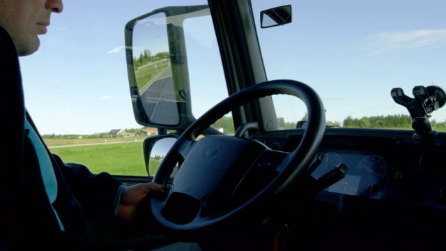 Inside of the Cabin View of the Professional Truck Driver Driving His Big  Vehicle on the Road. video