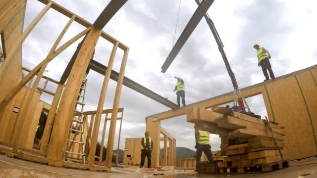 time-lapse inside rooms of the prefab wooden home being put up along with the first floor - drewno materiał budowlany filmów i materiałów b-roll