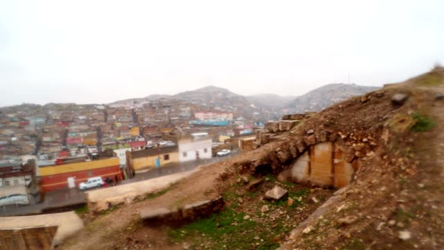 Inside Ruins of Urfa Castle on Background Slum Snow and Rain video