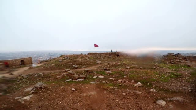 Inside Ruins of Urfa Castle Turkish Red Flag on Wind Snow and Rain video