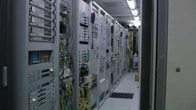 Inside telecom server room, panorama Inside telecom server room. Rack view. Optical equipments server room stock videos & royalty-free footage