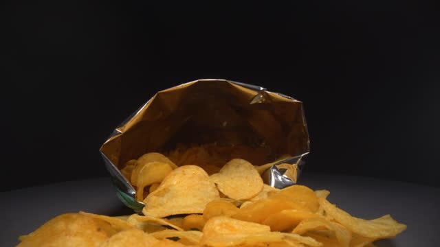 Inside the potato chips bag Inside the potato chips bag potato chip stock videos & royalty-free footage