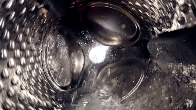 hd - inside the washing machine drum - struttura pubblica video stock e b–roll