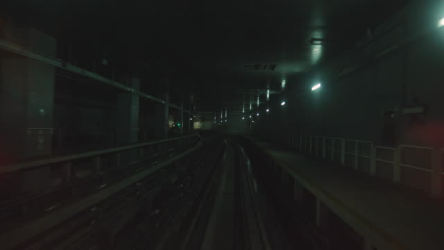 Inside view of a train traveling underground.