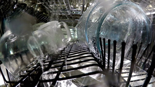 Inside view on washing of ware in the dishwasher Inside view on washing of ware in the dishwasher, dishwasher stock videos & royalty-free footage