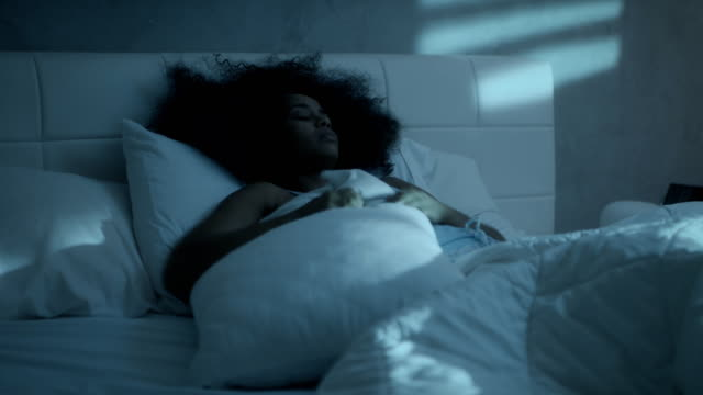 Insomnia For Young Black Woman Sleeping In Bed At Home Young latino woman sleeping in bed at home. Restless sleep for african american girl in bedroom. People suffering with anxiety disorder and having health problem insomnia stock videos & royalty-free footage