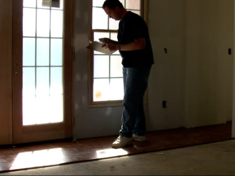 Inspecting House Man checking house. quality control stock videos & royalty-free footage