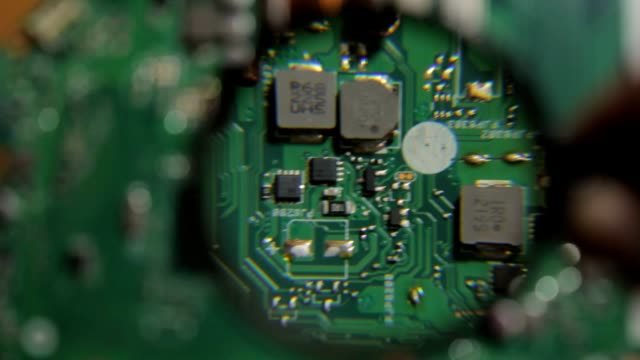 Inspection of chip laptop motherboard under a magnifying glass video