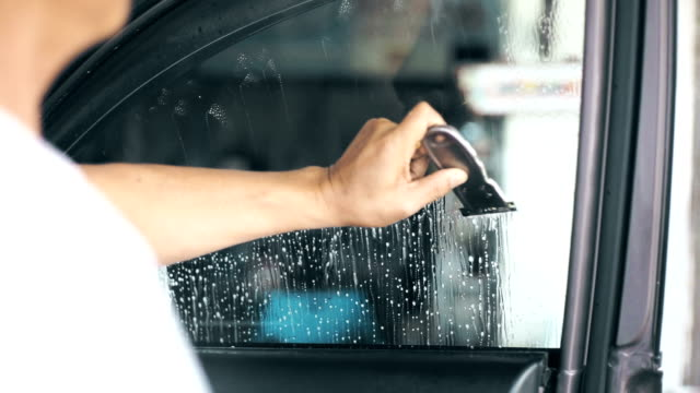 installation of car window tint, hand cleaning and scraping the window surface. - aluminum foil stock videos & royalty-free footage