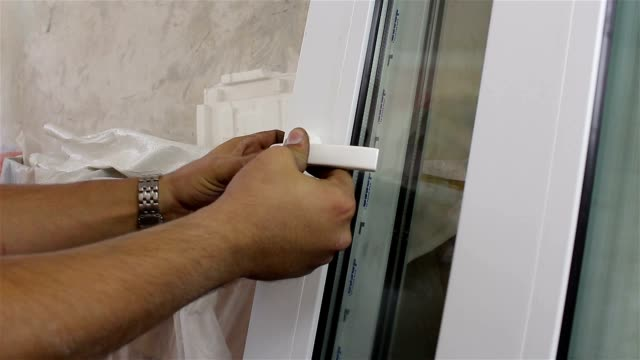 installation of window handle. installation of windows. fittings video