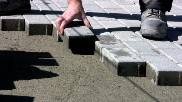 Installing Sidewalk Bricks On A Sunny Day (HD 1080p30) video