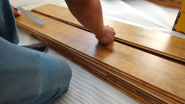 Installing the wooden floor Installing the wooden floor craftsman architecture stock videos & royalty-free footage