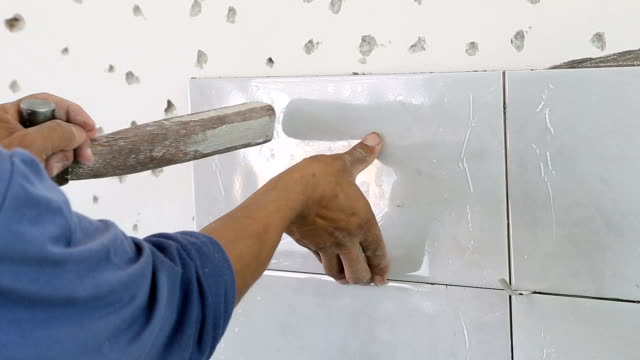 Installing Wall Tile. Installing Wall Tile, hand held shot. bathroom stock videos & royalty-free footage