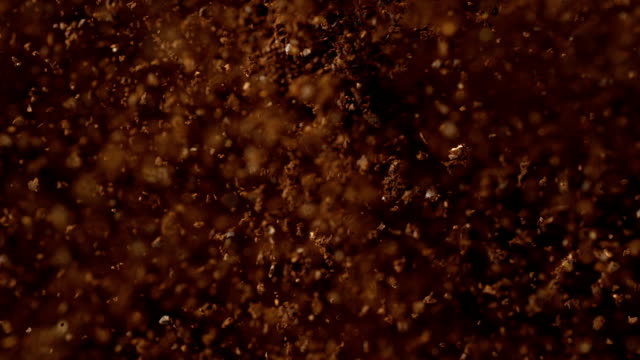 Instant coffee pieces falling and hitting ground Falling instant coffee pieces hitting ground. Super slow motion. Close up. Camera trajectory controled by fast robot arm. Camera Phantom. spice stock videos & royalty-free footage