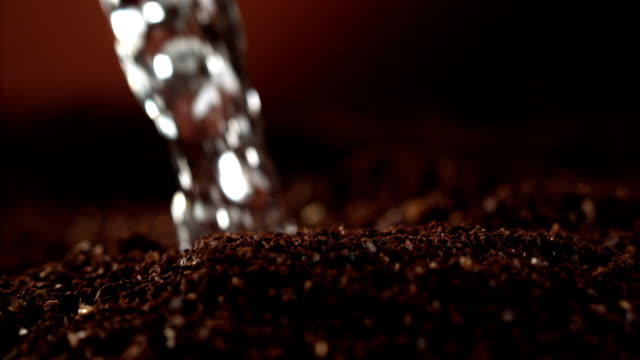 Instant coffee pieces mixing with hot water video
