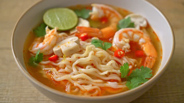 instant noodles ramen in spicy soup with shrimps (Tom Yum Kung) - Asian food style.