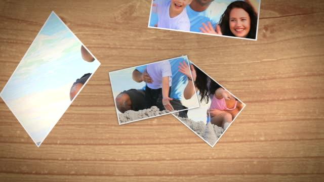 vídeos de stock, filmes e b-roll de fotos instantâneas caindo e mostrando uma família na praia - polaroid
