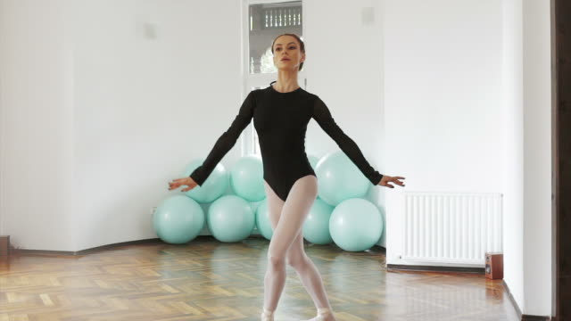 Instructor ballerina dancing slow motion. video