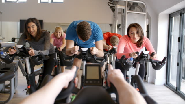instructor's pov of exercising class at a gym - kurs ćwiczeń filmów i materiałów b-roll