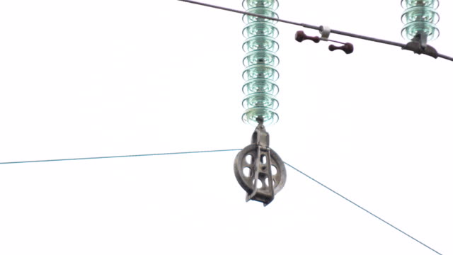 insulator with roller pulls electrical wire conducting current