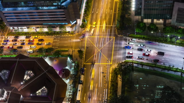 Intense high angle view timelapse during rush hour with local traffic and cummuters in downtown Singapore in supreme quality (4K/UHD to HD) - Stock Video video