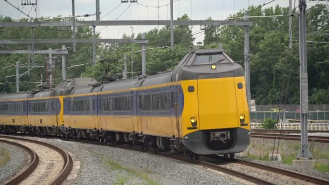 intercity train with passengers passing - intercity filmów i materiałów b-roll
