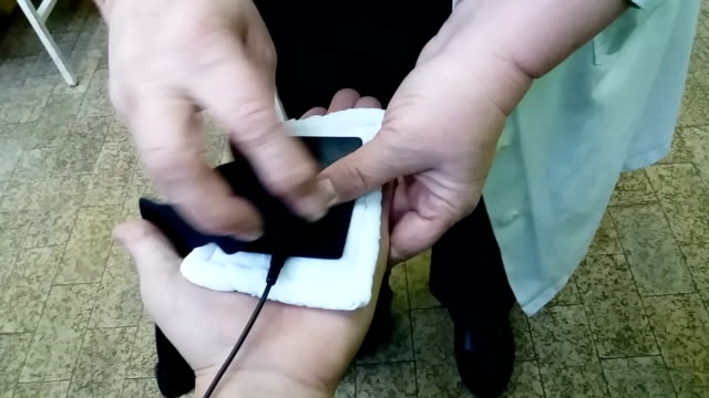 Interferential current Physiotherapy on patient hand Interferential current Physiotherapy on patient hand electrode stock videos & royalty-free footage