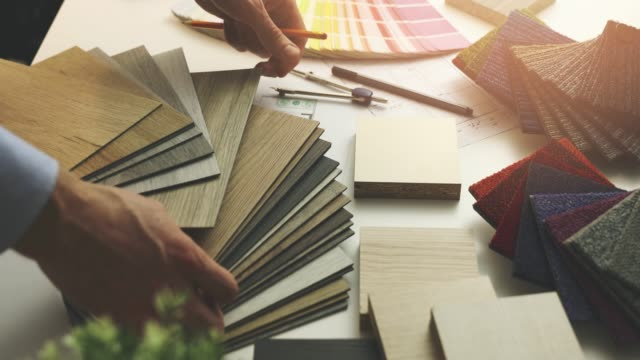 interior designer choosing flooring and furniture materials from samples for home interior design project in office interior designer choosing flooring and furniture materials from samples for home interior design project in office fabric swatch stock videos & royalty-free footage