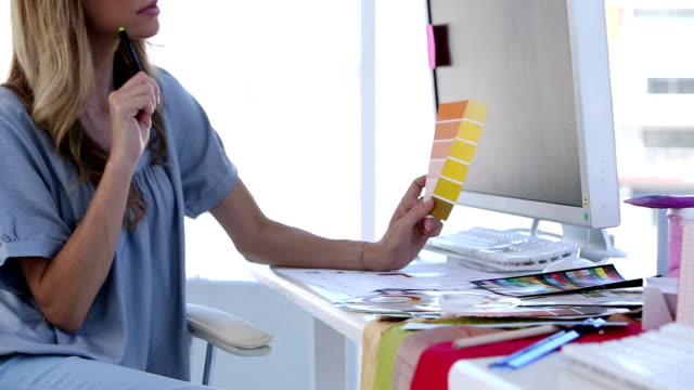 Interior designer looking at color chart video