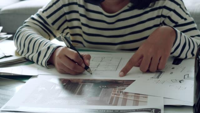 Interior designer sketching : home design