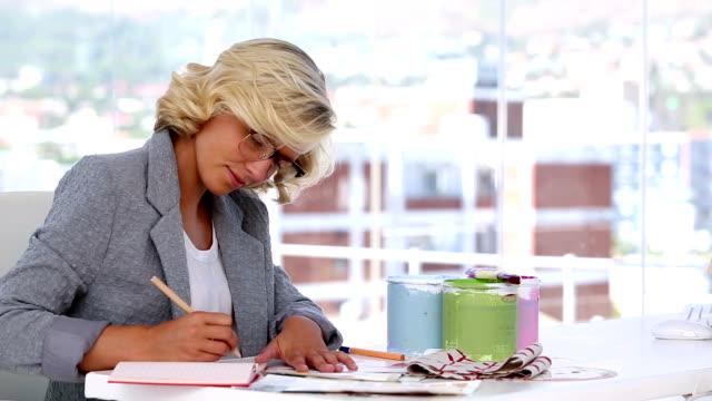Interior designer taking notes video