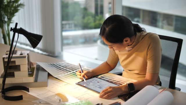 Interior designer working on Digital tablet Interior designer working on Digital tablet interior designer stock videos & royalty-free footage