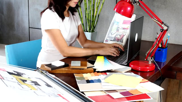 How Interior Designers Work Interior Designer Using Laptop In Modern Office Hd Video & 4K B .