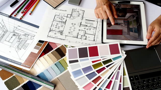 Interior designer working Top view of interior designer hands working with tablet computer,fabric swatch, shop drawing and material sample / Home interior decoration and renovation planning concept interior designer stock videos & royalty-free footage