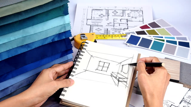 Interior designer working Top view of interior designer hands working with fabric swatch, shop drawing and material sample / Home interior decoration and renovation planning concept interior designer stock videos & royalty-free footage