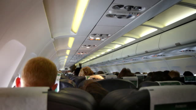 Interior of a crowded Aeroplane. HD, NTSC, PAL video