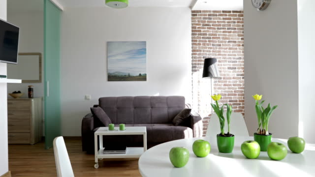 4K. Interior of a new modern apartment in scandinavian style. Motion panoramic view 4K. Interior of a new modern apartment in scandinavian style. Motion panoramic view. NOTE: PHOTO ON THE WALL WAS MADE AND PRINTED BY ME!!! interior designer stock videos & royalty-free footage