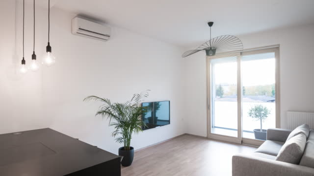 Interior of a new modern apartment Interior of a new modern open floor plan apartment with minimalist furnishing, moving from the kitchen to the living room house rental stock videos & royalty-free footage