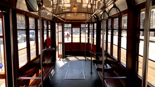 interior of a typical historic milan tram with wooden interiors 2. 4k quality - milan railway video stock e b–roll