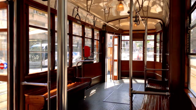 interior of a typical historic milan tram with wooden interiors. 4k quality - milan railway video stock e b–roll