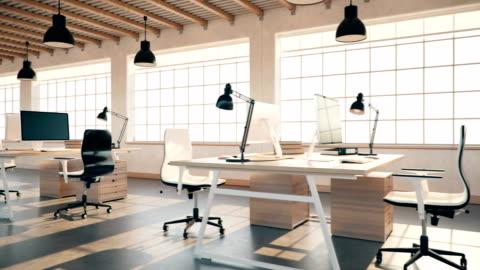 vidéos et rushes de espace ouvert de l'intérieur d'un vide moderne loft office - bureau ameublement