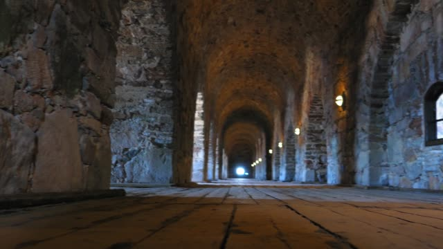 interior of ancient castle corridor with stone walls and wooden floor - пешеходная дорожка путь сообщения стоковые видео и кадры b-roll