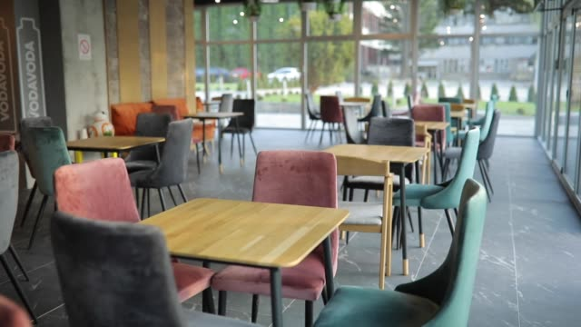 Interior of cafeteria Inside of modern cafe with chairs and tables, without people, on day cafeteria stock videos & royalty-free footage