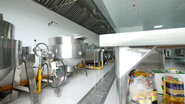 interior of commercial kitchen in hotel - pentola a vapore video stock e b–roll