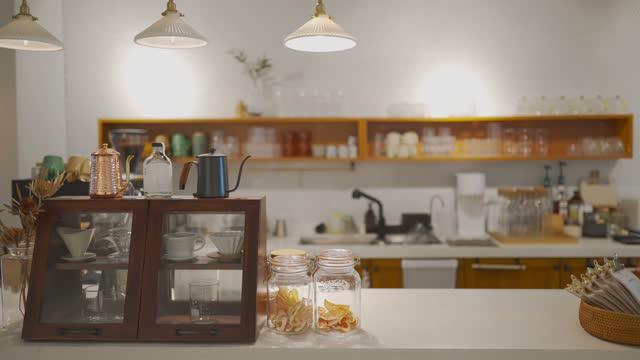 interior of cozy café coffee shop small business at counter