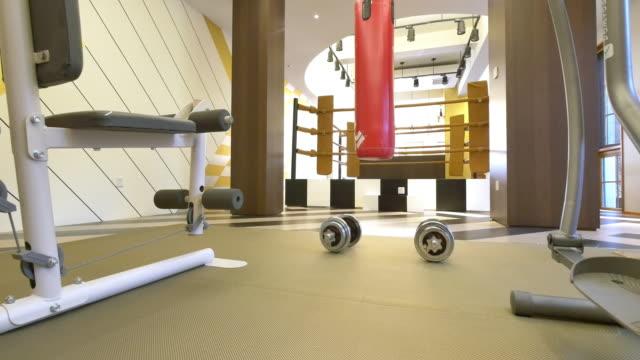 interior of gym in modern villa 4k video