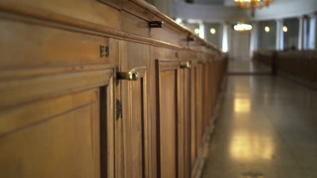 Interior of Helsinki cathedral Interior of Finland cathedral. Moving along rows of benches and wooden vintage doors with bronze numbers neoclassical architecture stock videos & royalty-free footage