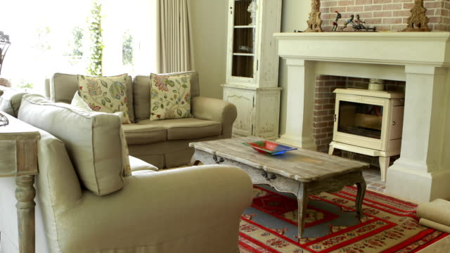 interior of living room with sofa and fireplace - living room stock videos and b-roll footage