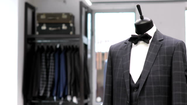 4ad2b863cb9 Interior Of Mens Clothing Store Mens Suits Mens Shirts Expensive Boutique  Buying Clothes In A Boutique Stock Video - Download Video Clip Now - iStock
