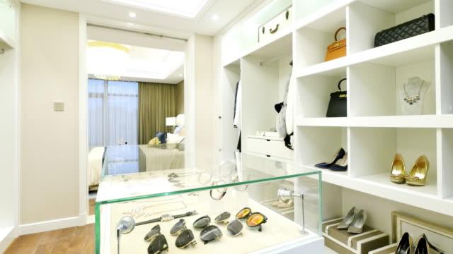 https://media.istockphoto.com/videos/interior-of-modern-wardrobe-video-id629808040?s=640x640